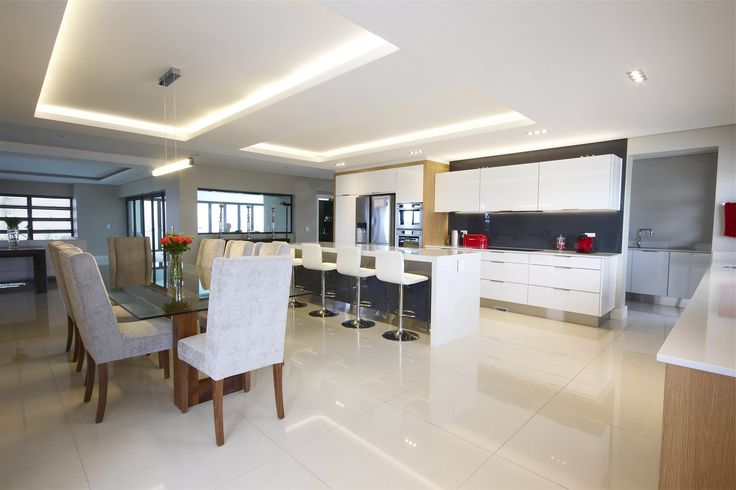 Full kitchen view of a house in Baronetcy Estate with High Gloss PET #SCD #Kitchen www.supdoor.com