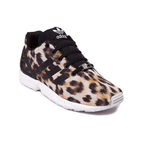 Take a walk on the wild side with the new ZX Flux from adidas! This throwback running shoe style from the 80's is coming back with a modern look that delivers, featuring leopard printed textile uppers with rubber moulded heel cage for stability and signature adidas side stripes. Features include Breathable textile uppers Rubber moulded heel cage provides durable stability