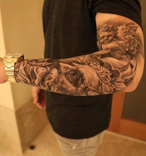Realistic Mural/statue looking forearm tattoo