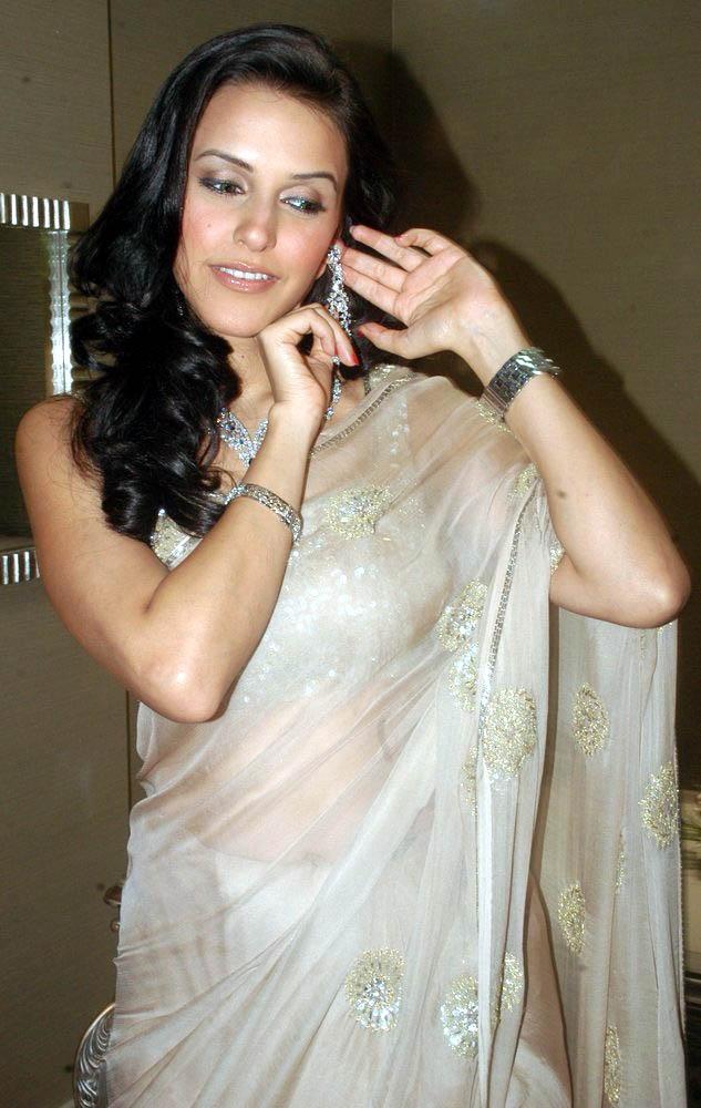 Neha in a classic white sari.