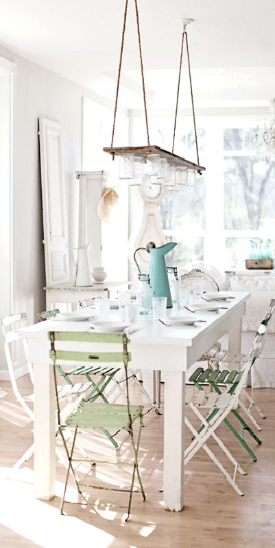 love the green chairs and that they are not at each end and love the rack hanging over the table