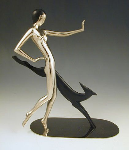 DescriptionChrome plate on brass and ebony woman walking a Greyhound, very much in the syle of Hagenauer  Country of ManufactureAustrian  Datec.1935
