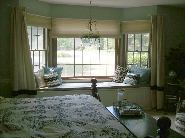 Remarkable Brown Bedroom Bay Window Design Idea with Cream Curtains and Blue White Black Throw
