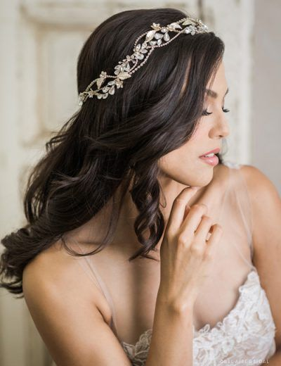 Tuesday, May 16, 2017 Enrich your bridal ensemble with a beautiful weaving garland. This gorgeous wreath has rhinestone clusters, sparkling chains, gilded leaves and tiny metal flowers that create beautiful accent. This lovely design from Bel Aire Bridal, style 6752, is secured with metallic ribbon ties and can be worn with or without a veil. …