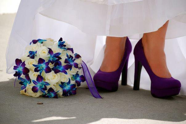 Wedding bouquet with white roses and blue and purple orchids Found my purple heels to match! :)