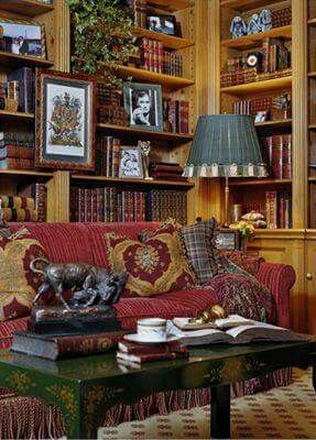 Country English library/sitting room. Love the warm colors and mix of textiles.