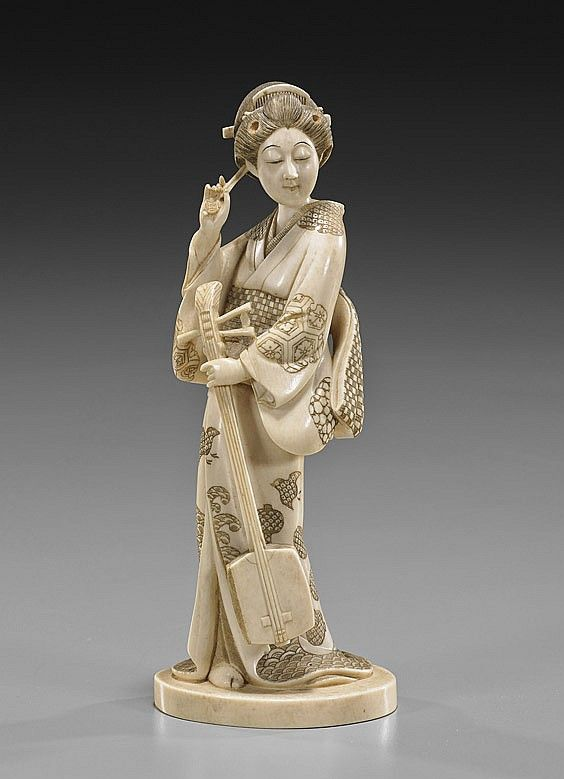 Japanese carved ivory and scrimmed figure of a standing