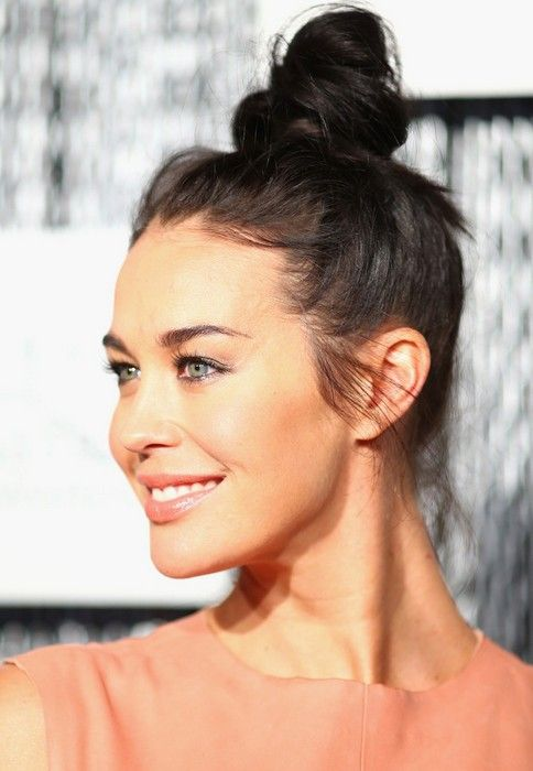 Megan Gale sporting a top knot hairstyle