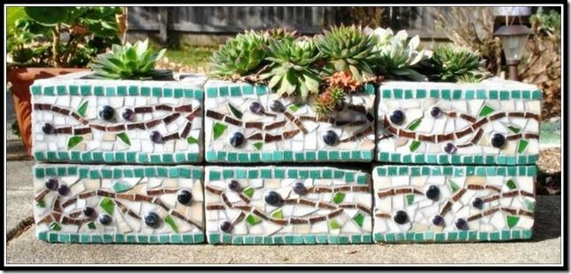 Mosaic cinderblock raised garden bed....or let vine grow on it.  Maybe design bar supports with the blocks and a wooden top.