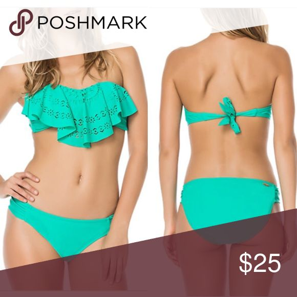 NWT Jessica Simpson Emerald Bandeau Bikini Jessica Simpson Emerald Flounce Bandeau Bikini. Size Medium Top & Bottom. New with attached tags. Fun laser-cut ruffles in a strapless design. Back tie closure. Nylon/spandex. 📦 Bundle with another item for a 15% discount. Jessica Simpson Swim Bikinis