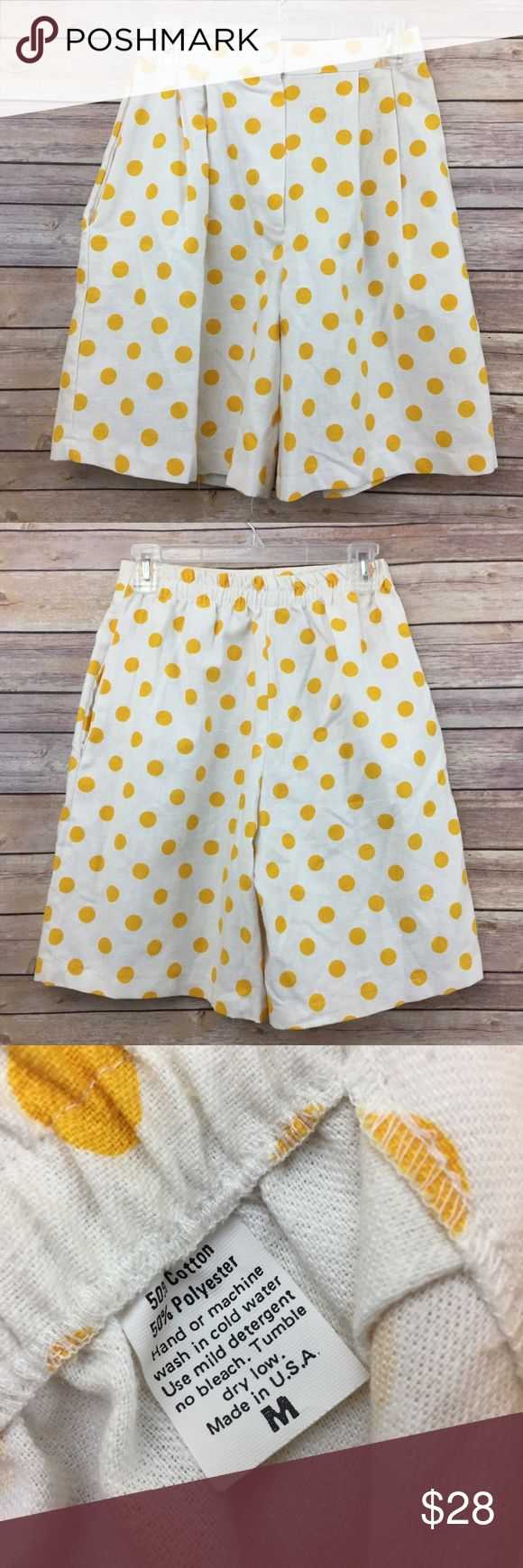 "Vintage 1980's polka dot hi-waist shorts Med 229 These awesome vintage 1980's Polka dot shorts are a high waisted mom style! They are white with bright yellow polka dots and are marked a size medium but as they're vintage check measurements! They measure 13"" flat across the waist with a rise of 14"" and an inseam of 8"".  They are in good preowned condition with no flaws and light overall wear Vintage Shorts Bermudas"