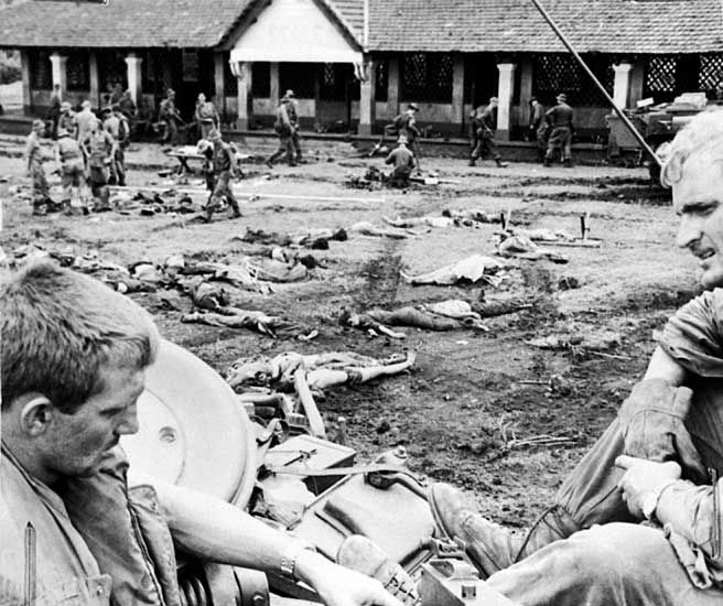 The bodies of North Vietnamese Army (NVA) troops who attempted to hold the rubber plantation village of Binh Ba, are laid out in an open area so they can be checked for documents by the Australians before burial