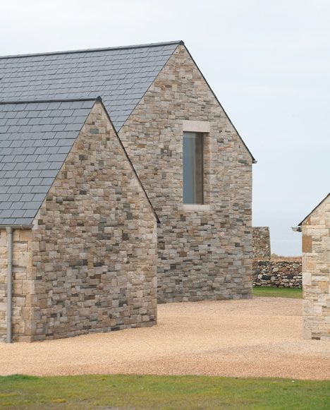 House in Blacksod Bay by  Tierney Haines Architects, Three sandstone wings protect an inner courtyard from fierce coastal winds at this seaside house in Ireland by Tierney Haines Architects.