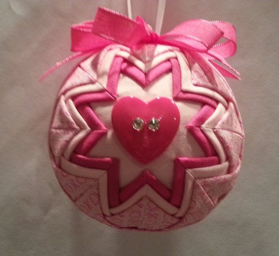 A Valentine quilted ornament with heart buttons and crystals. Fabric has Xs and Os.