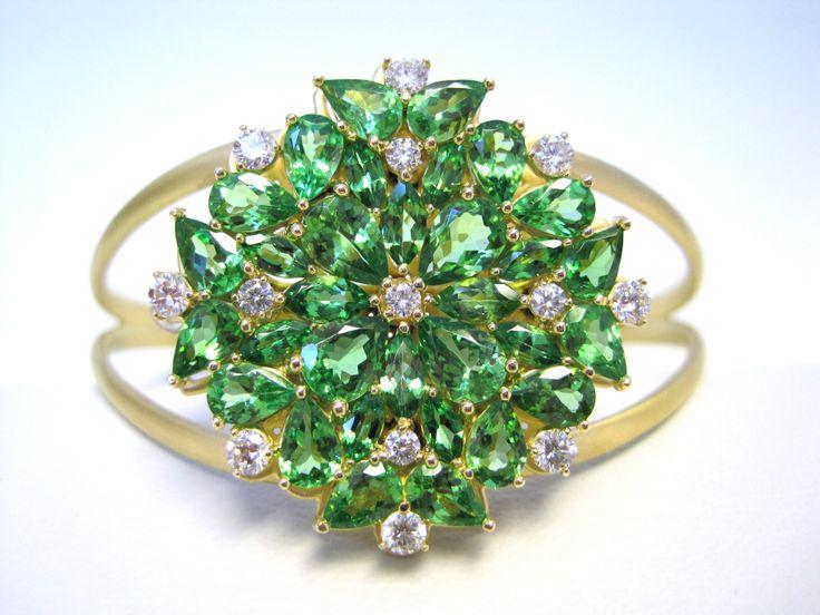 Corona Cuff Bracelet 18-K yellow gold brush finished cuff bracelet 32 marquise, pear shape Tsavorite: 13.45 tcw 13 round brilliant diamonds: 1.05 tcw Prong setting