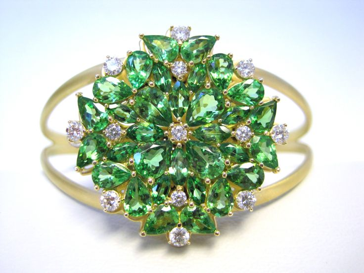 Corona Cuff Bracelet 18-K yellow gold brush finished cuff bracelet 32 marquise, pear shape Tsavorite: 13.45 tcw 13 round brilliant diamonds: 1.05 tcw Prong setting