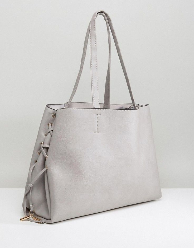 Get this New Look's shoulder bag now! Click for more details. Worldwide shipping. New Look Lace Up Tote Bag - Grey: Bag by New Look, Faux leather outer, Twin handles, Lace-up sides, Wipe clean, 100% Polyvinylchloride. Transforming the coolest looks straight from the catwalk into wardrobe staples, New Look joins the ASOS round up of great British high street brands. Get it or regret it with its weekly drops of essential coats, statement partywear and sleek boots, from ankle to over-the-knee…
