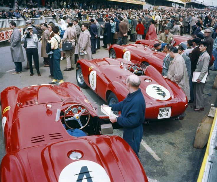 The #Ferrari team mechanics make last minute checks before the 1954 Le Mans race.
