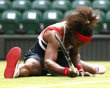 Serena Williams of the United States falls to the court after returning to Jelena Jankovic of Serbia in their women's singles tennis match at the All England Lawn Tennis Club during the London 2012 Olympics Games July 28, 2012. REUTERS/Stefan Wermuth - http://www.PaulFDavis.com/success-speaker (info@PaulFDavis.com)