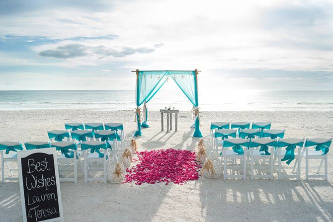 Like the color, white chairs, petal aisle. 670-tide-the-knot-beach-weddings-alter-blue.
