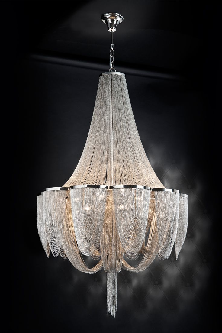 The Empire Metal Chain Chandelier is classically striking in any setting, shown here composed of thin metal chains in polished nickel finish. Available at Juliette's Interiors, a large collection of designer luxury lighting.