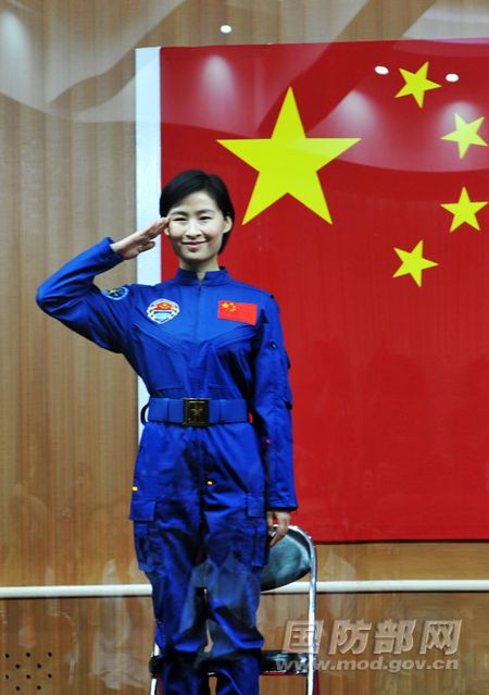 China's first female astronaut Liu Yang, an Air Force major, salutes to reporters during a press conference on the eve of her June 16, 2012 launch with two crewmates on the Shenzhou 9 mission to the Tiangong 1 space lab.