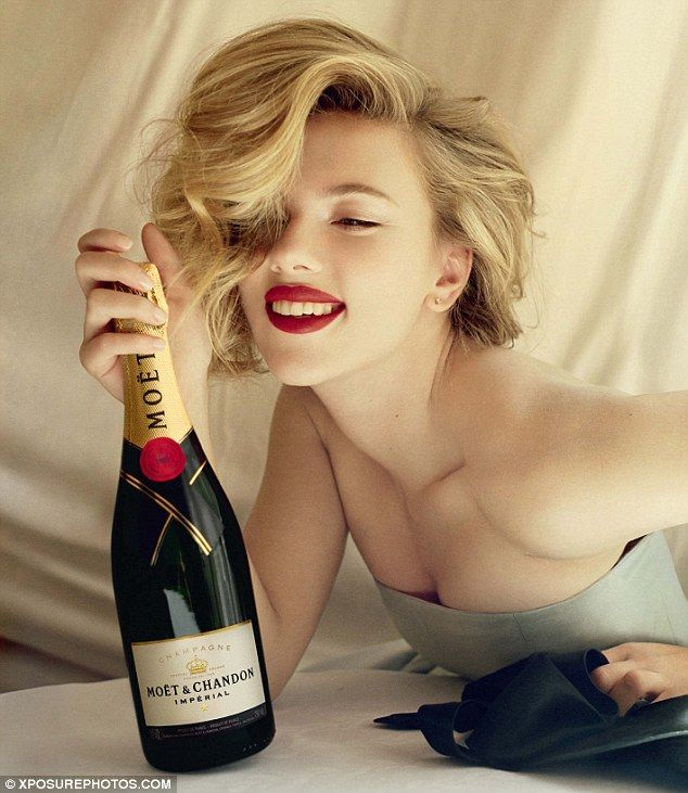Champagne chic: Scarlett Johansson strikes [insert an adjective or two] pose for the new advertising campaign for Moet & Chandon. Typically champaign is a once or twice a year thing for most of us, and then it's Veuve Clicquot. But a wee more Scarlett might quickly shift that balance. For this effort, Moet has created a great advert and campaign. Well done.