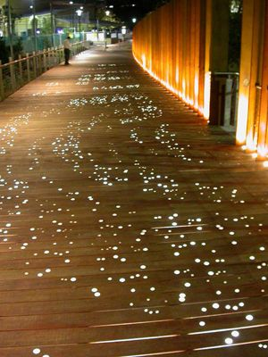Professor Paul Carter developed the Golden Grove project as part of the Maze Green redevelopment project at the University of Sydney, in collaboration with landscape architects Taylor, Cullity and Lethlean. Golden Grove is located on the boardwalk at the western exit of Maze Green. It uses a combination of ground patterning, dispersed and embedded lighting and stencilled poetic texts