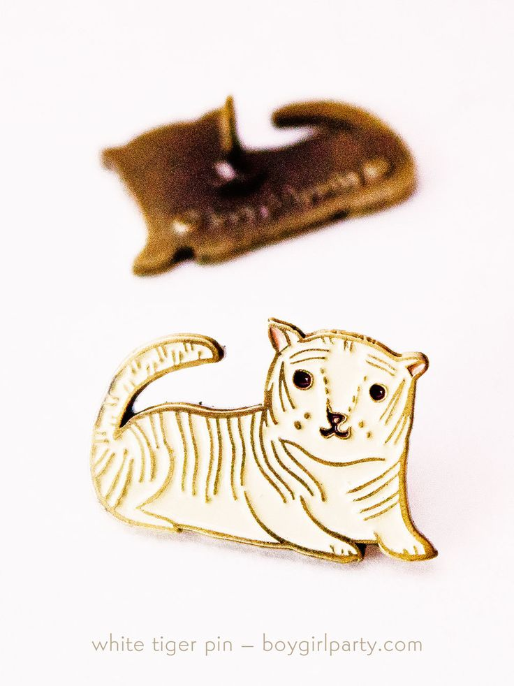 White Tiger Enamel Pin by Susie Ghahremani / boygirlparty – available at: https://www.etsy.com/boygirlparty/listing/248149615/white-tiger-enamel-pin-brass-pin-tiger?ref=shop_home_active_17 #enamelpin #enamel #pin