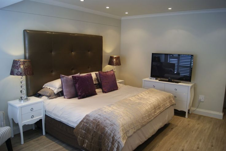 Luxury Bedroom with Large Bed, Dressing Table and Flat Screen TV