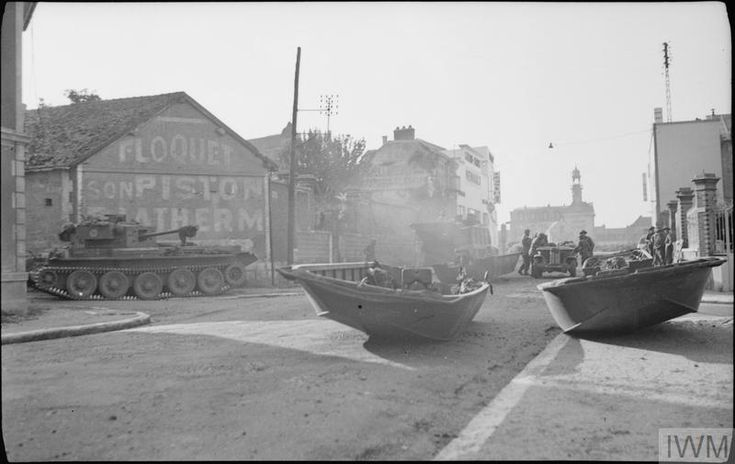 A Cromwell tank and some of the boats used for croosing the River Seine at Vernon, 25 August 1944.