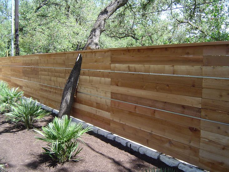 Backyard Fence Thick Trenched Stone Or Concrete Base To