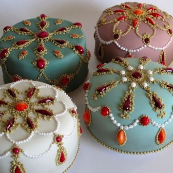 Bejeweled cakes for Christmas - rich fruit and nut cakes filled and coated with marzipan, fondant iced with glazed fondant 'jewels' and piping painted with gold edible lustre