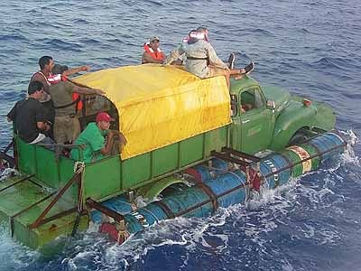 Twelve Cuban migrants attempt to cross the Florida Straights in a boat fashioned out of a 1951 Chevy pickup truck driving it within 40 miles of the United States before they were found by the U.S. Coast Guard and returned to Cuba.