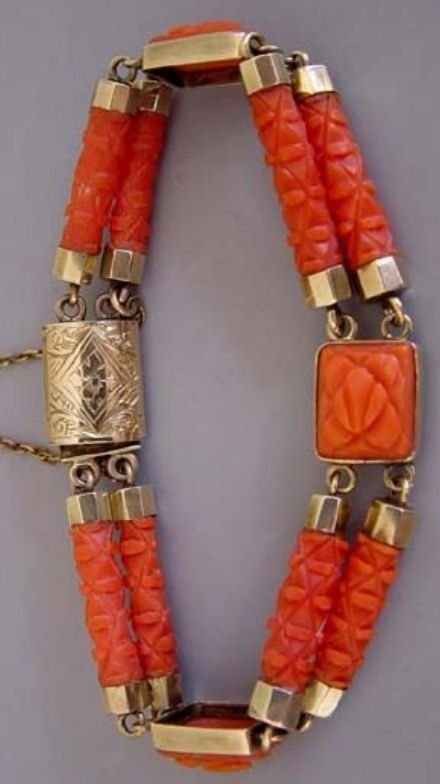VICTORIAN coral carved segments bracelet with square rosette and carved bar stations, yellow gold fittings