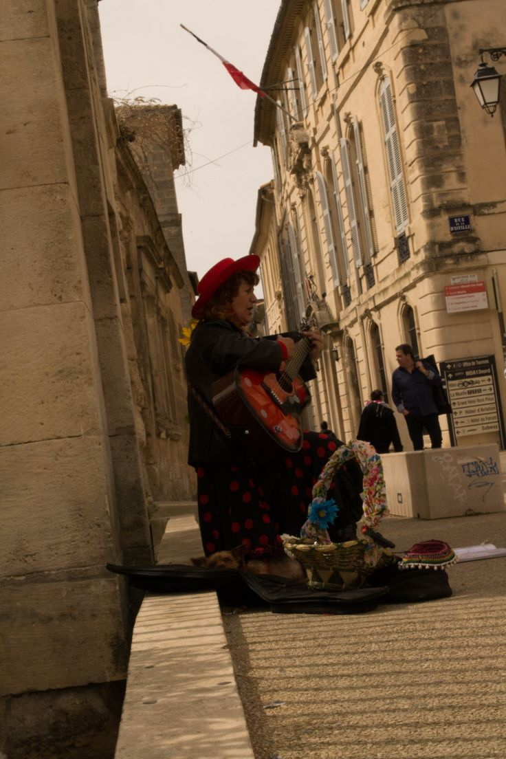 """#Street #Arles  A gypsy woman sing on the street of the most ancient spot of France for the opening of the """"corrida"""" on the first days of April"""