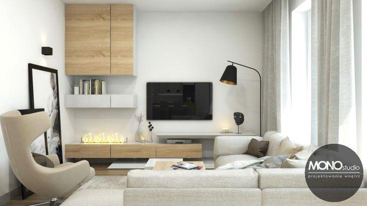 Głównym elementem salonu jest wygodna, duża sofa, która pozwala na zasłużony odpoczynek po ciężkim dniu pracy. Po więcej inspiracji zapraszamy na Naszą stronę internetową:biuro@monostudio.pl oraz na Facebooka