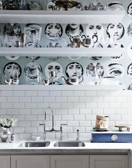 Want contemporary kitchen decorating ideas? Take a look at this contemporary kitchen with statement Fornasetti wallpaper and white metro tiles for decorating inspiration. Find more kitchen design and decorating ideas at theroomedit.com