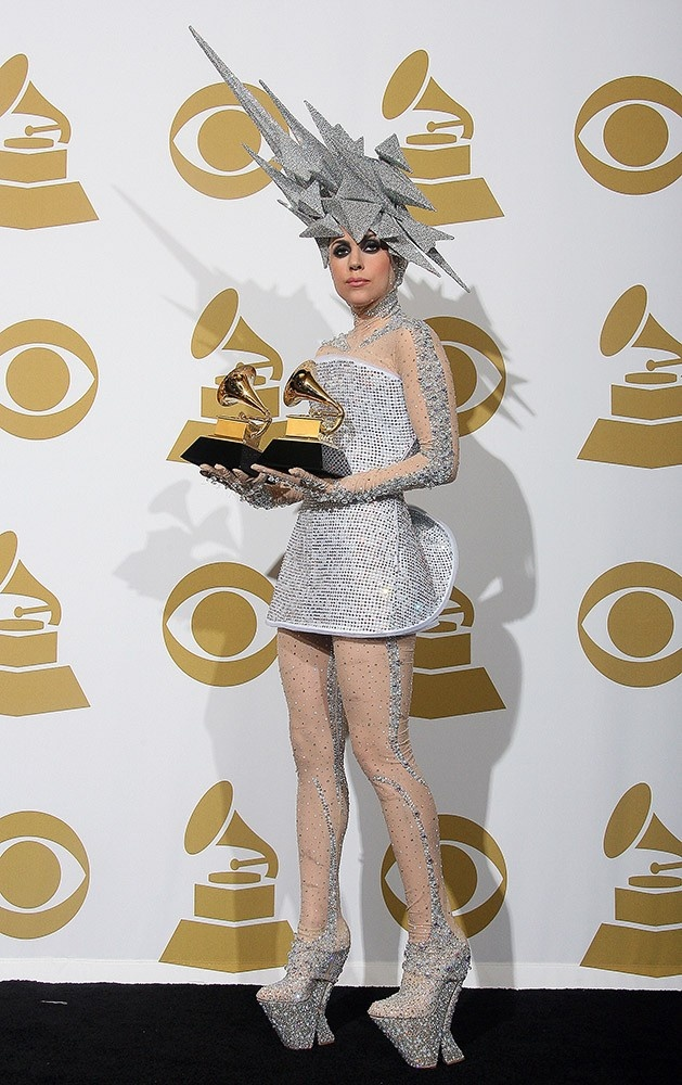 Talk about bedazzled! Lady Gaga accepts her Grammy in a futuristic sparkling masterpiece.