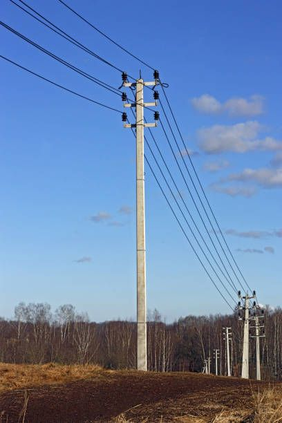 concrete supports with power transmission lines standing on hill