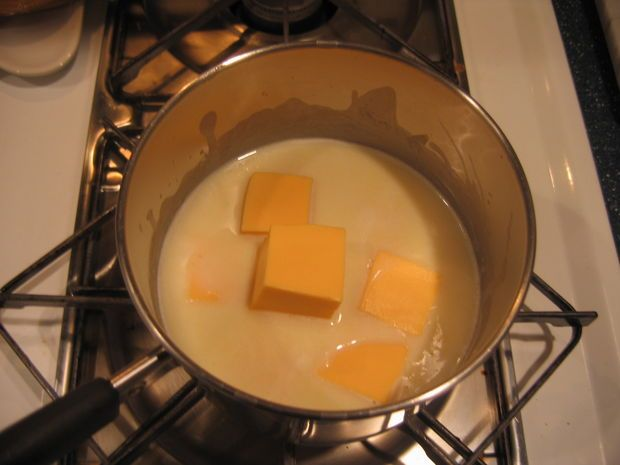 mom's Velveeta cheese sauce: Melt 3 T margarine in saucepan Take off heat, stir in 3 T flour Put back on medium heat; add 1 c milk, stirring constantly Add 1/2 c cubed Velveeta cheese; stir until melted. Serves 1-2
