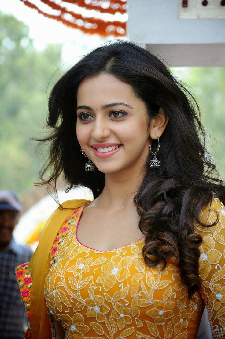Rakul Preet Singh Showcasing Her Firm Figure In Yellow Dress At Telugu Film 'Pandaga Chesko' Opening Event In Hyderabad more @ http://www.luvcelebs.com