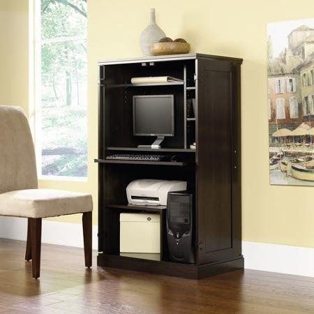 update your office with the sauder computer armoire with multiple finishes this lovely piece of office furniture features a pullout keyboard shelf