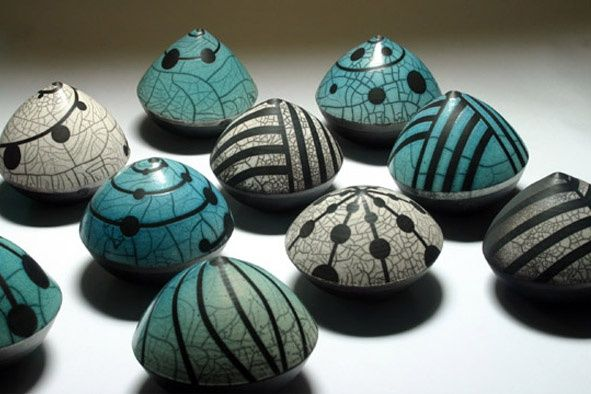 Eric Moss raku with paper resist 'strapped' pattern and crackle glaze
