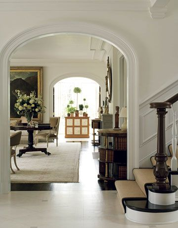 Round table with grand flower arrangement for foyer.: Idea, Black Stairs, Floors, Arches Doorway, Stairs Runners, House, Homes, Entrance, White Wall