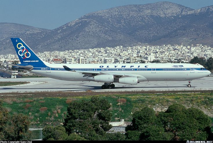 A340-313X Olympic Air, Athens in the background. Photographer Sam Chui.