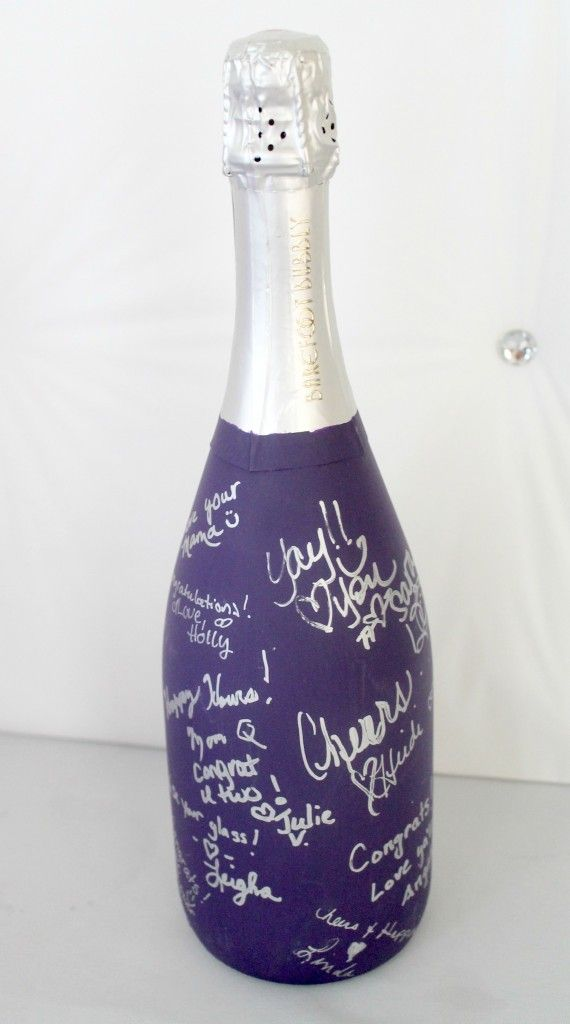 Chalkboard paint a champagne bottle and use for guests to sign - it will then be drunk on the anniversary, wedding etc