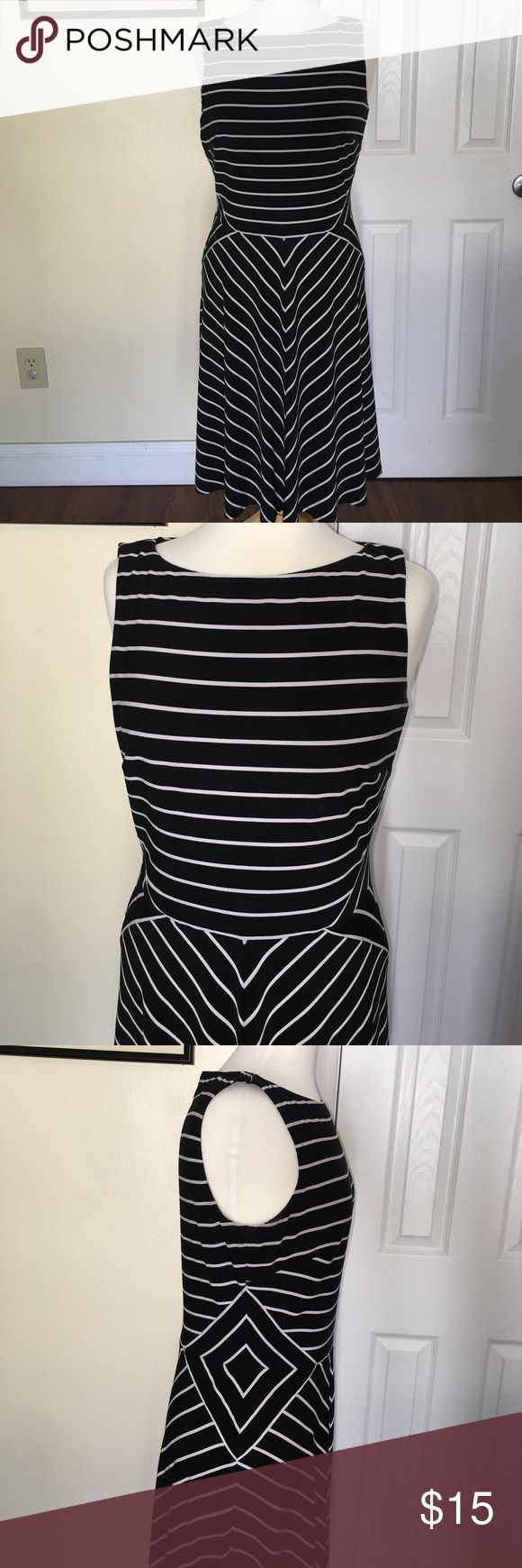 Classic Lauren Ralph Lauren Black & White Dress This classic, boat neck black and white striped dress is flattering and flirty. Wear to work with a jacket and throw on white adidas or your favorite sandals and floppy hat for the weekend! It's in gently, good used condition. Top is fitted and bottom is flowy/flared. Make me an offer! Lauren Ralph Lauren Dresses