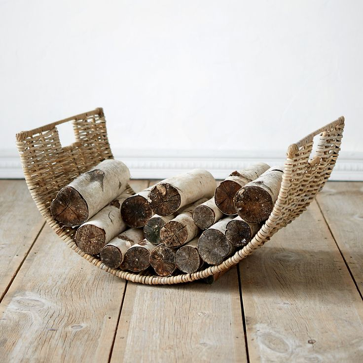 """A beautiful addition to the hearth, this wicker log basket holds abundant kindling for fireside evenings.- Wicker- Indoor or sheltered outdoor use- Imported15.25""""H, 19.4""""W, 28""""L"""
