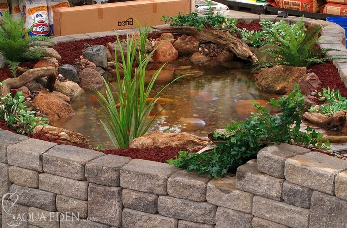 Pond with retaining wall block minnesota ponds for Indoor koi fish pond